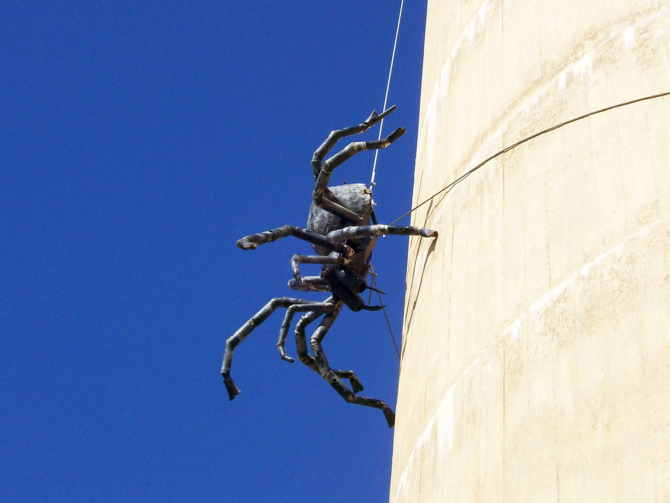 the big spider sculpture on the side of a water tower