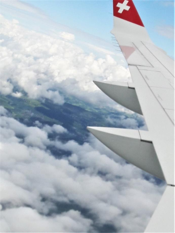 A picture containing sky, outdoor, plane, clouds  Description generated with very high confidence