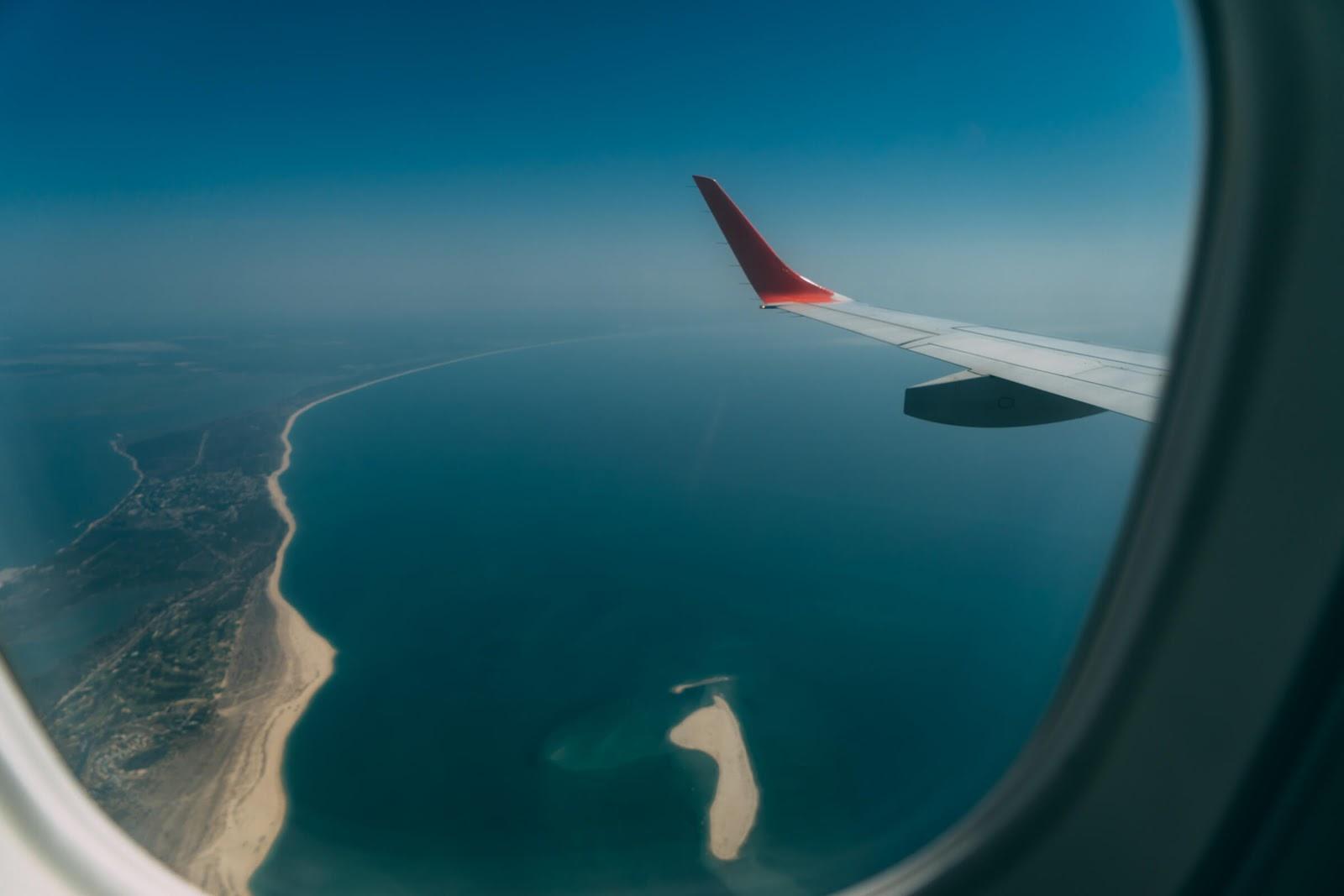 Dicas de viagem para não passar apuros - Seja otimista em seu voo e seja otimista