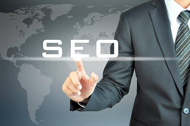 Businessman hand touching SEO (or Search Engine Optimization) sign Businessman hand touching SEO (or Search Engine Optimization) sign on virtual screen - internet & online marketing concept seo stock pictures, royalty-free photos & images