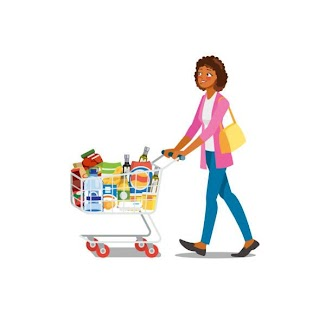 [Image is a person with very curly brown hair, medium tone skin, a pink jacket, a yellow purse, and blue jeans pushing a grocery cart full of groceries: many bottles and bags of different sizes and colors.]