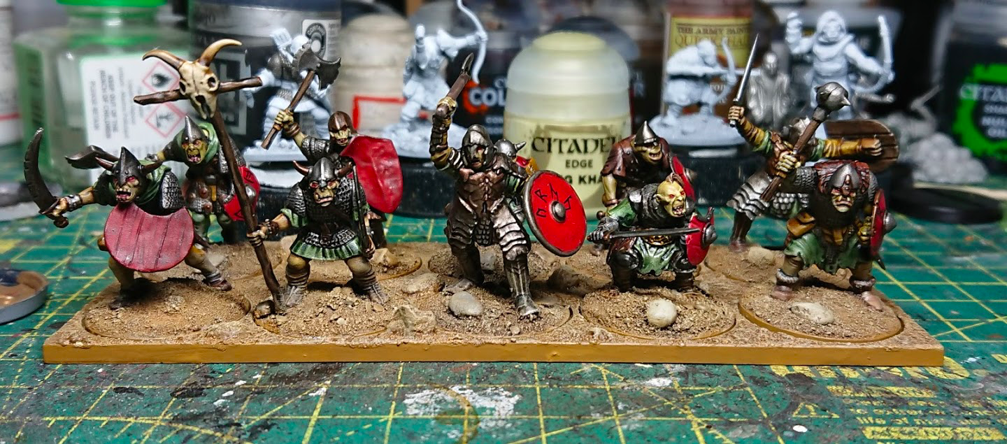 A small unit of hunched Goblin warriors, carrying shields and an assortment of weapons