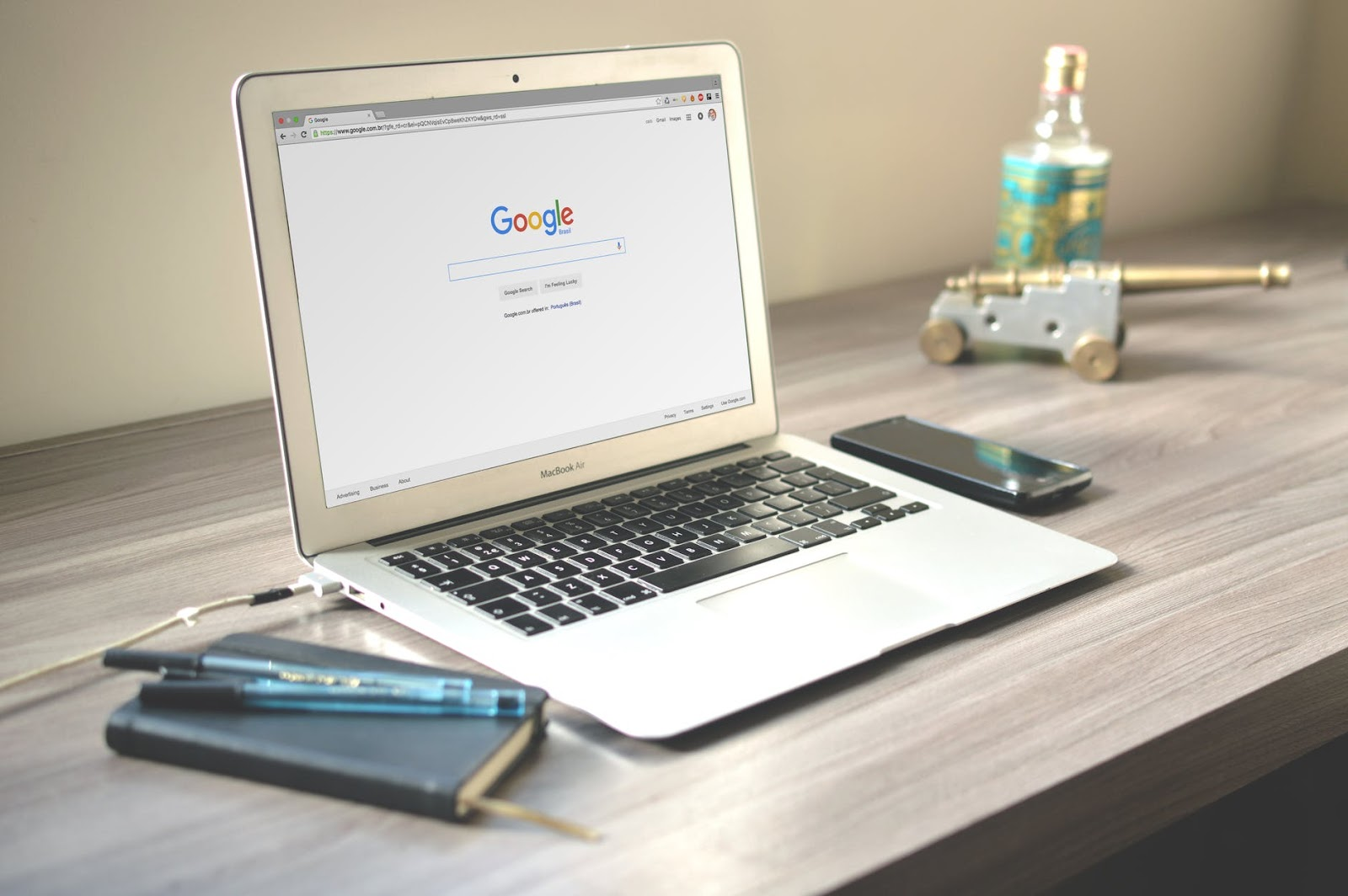 a silver laptop with google chrome  on the screen.
