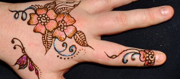 mehndi design filled with glitters and sparkle.