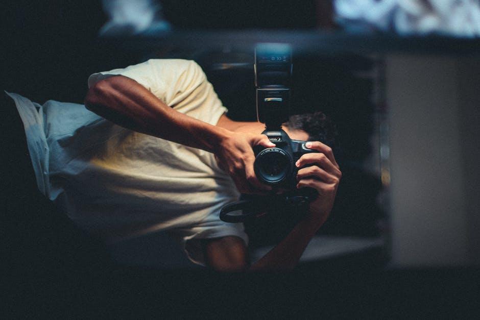 Man Taking Photo Of Himself