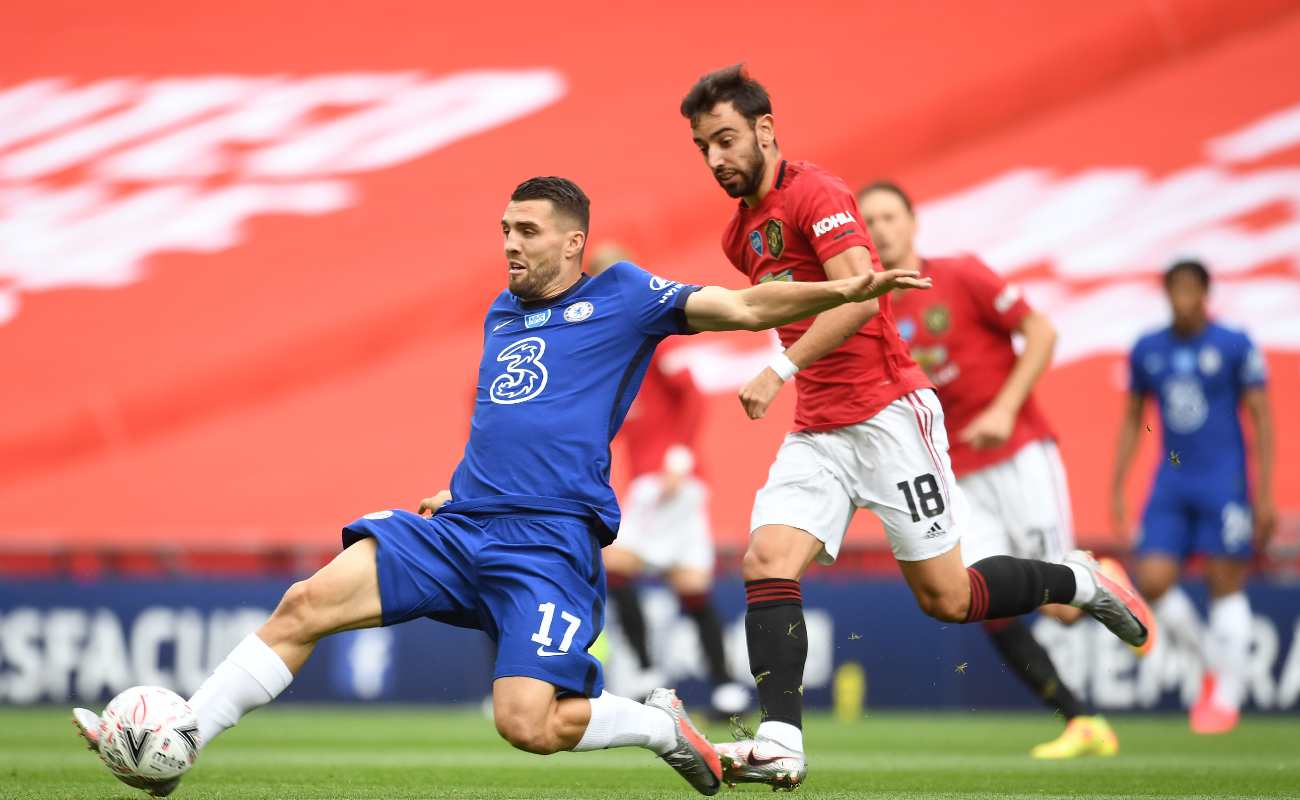 Matteo Kovacic of Chelsea steals the ball from Man United's Bruno Fernandes