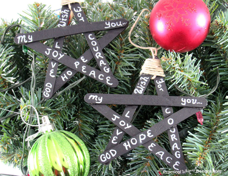 craft sticks painted black and hung for DIY ornaments with words- joy, peace, god, hope written on them