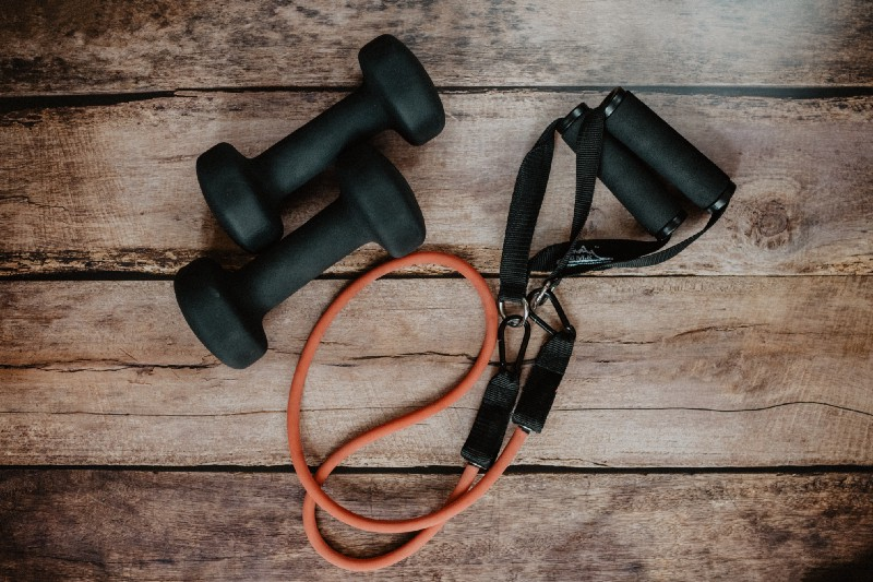 Picture of a jump rope and dumbbells to show how important exercise is in fat-loss over fifty.