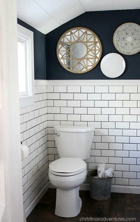 traditional bathroom remodel with navy wall paint, bohemian decor and traditional subway tile backsplash