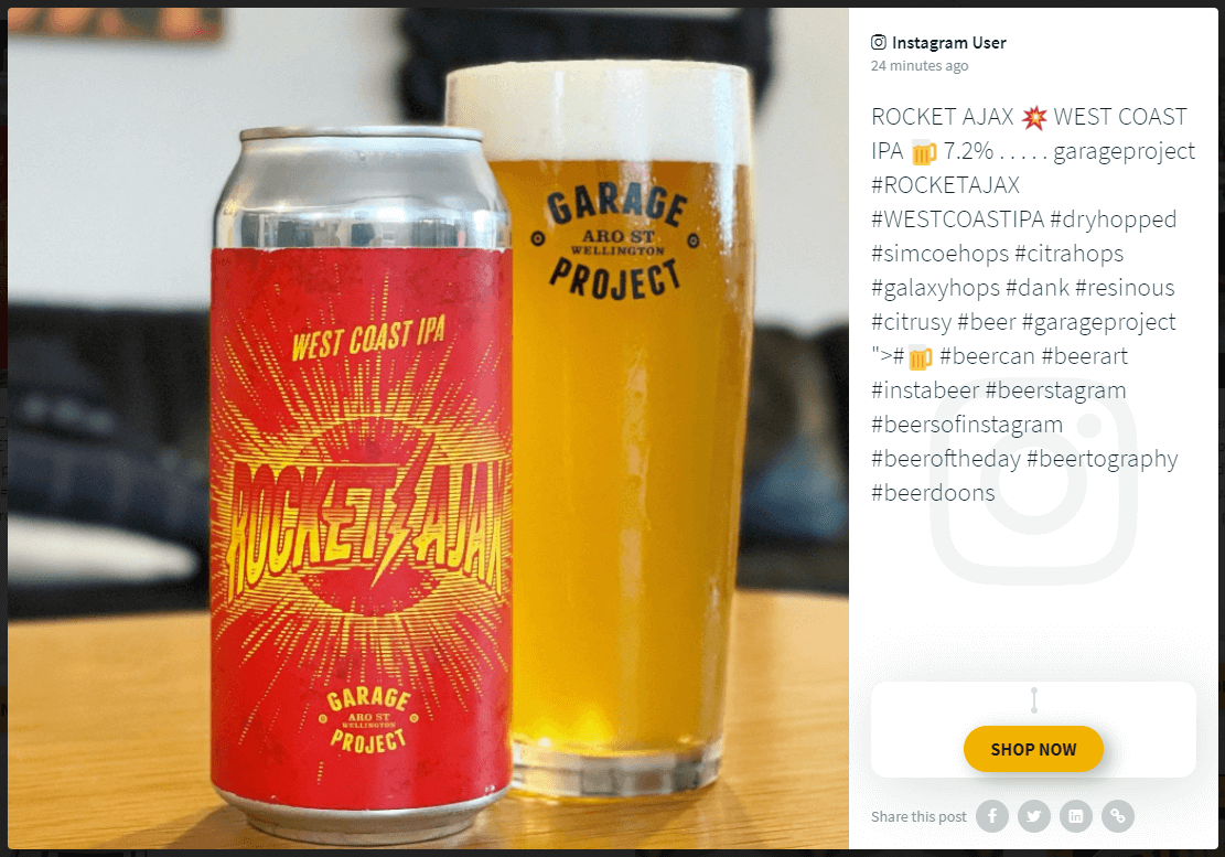 """Screenshot of a social media post on a social wall: The image shows a can of craft beer and a glass full of beer. The post caption shows a description of the beer and a call-to-action button titled """"Shop now."""""""