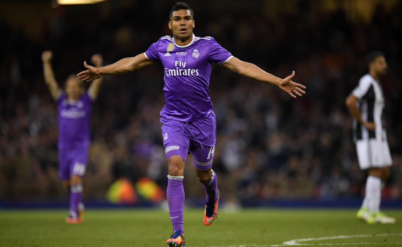 Alt: Real Madrid midfielder Casemiro celebrates scoring a goal - Photo by Quality Sport Images/Getty Images