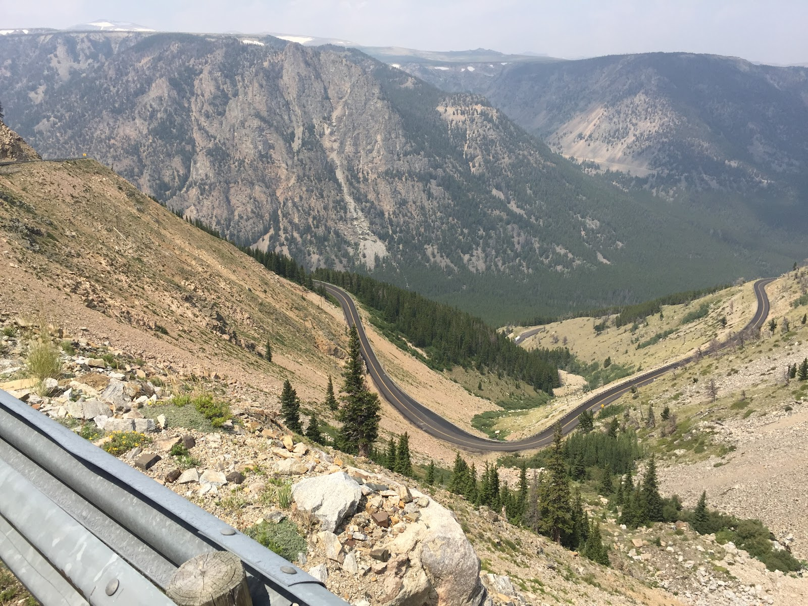 Bicycle ride up Bear Tooth Pass North - roadway far below