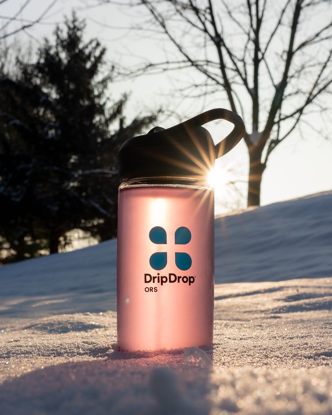 How to drink more water when you don't like it: bottle of water in the snow
