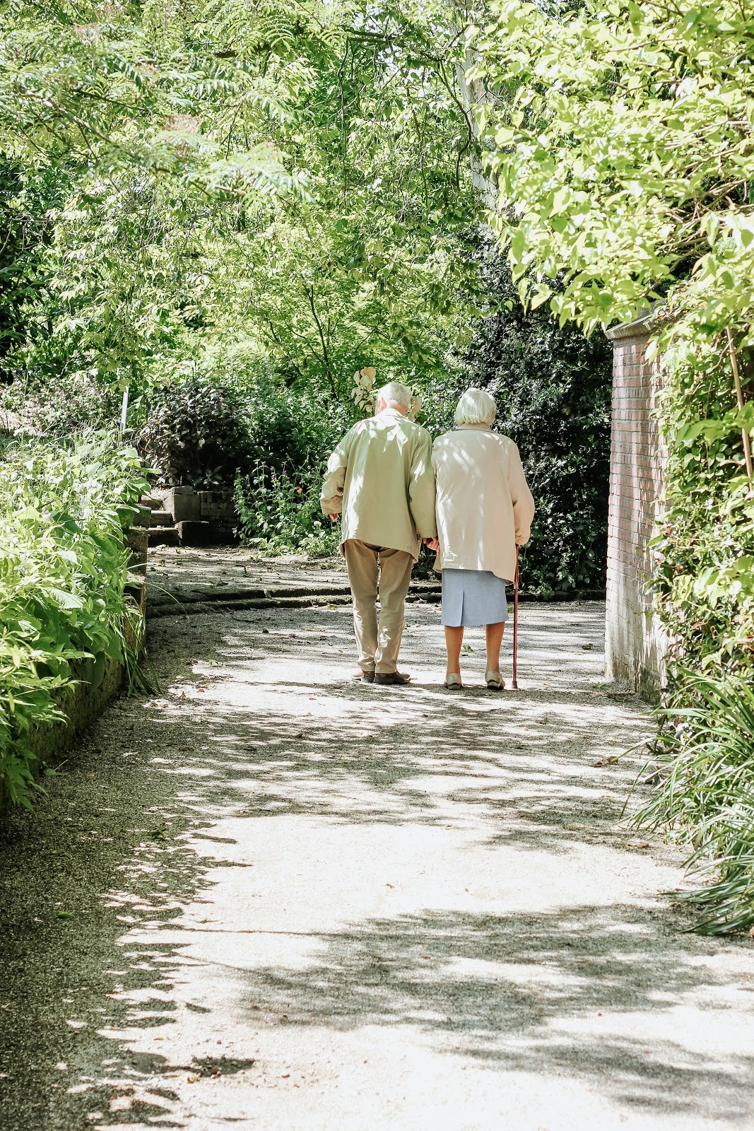 Retired couple walking outdoors senior living community jenny abrams home solutions inverness chicago