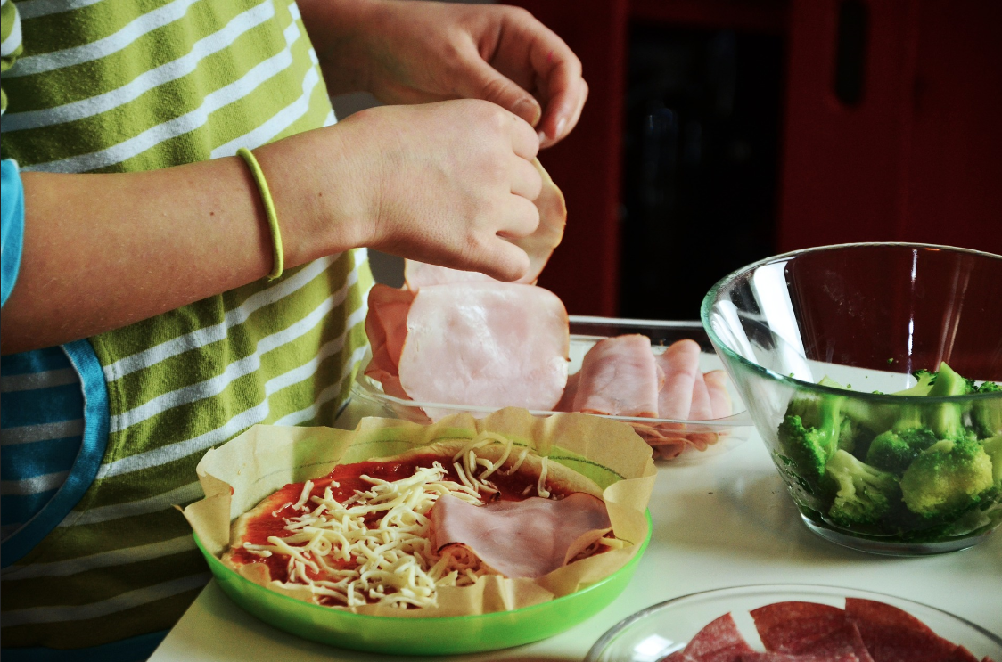 A person making a meal