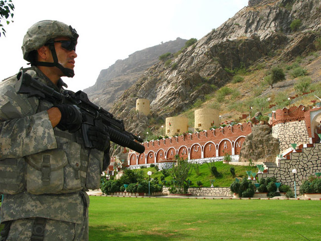 14) Afghanistan and Pakistan - US soldier on watch at the Torkham Gate, which divides Afghanistan from Pakistan, and is a major border crossing between the two countries.