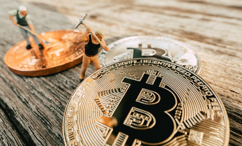 small men mining bitcoin
