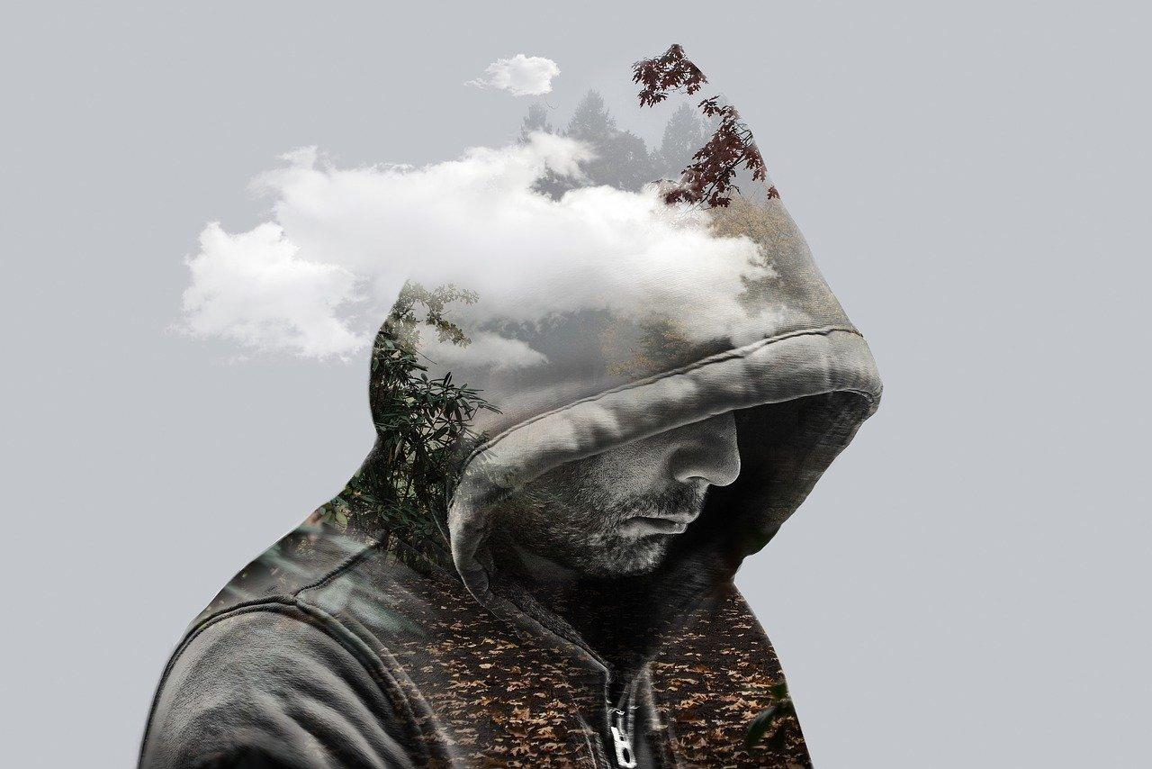 man in hooded sweatshirt with clouds