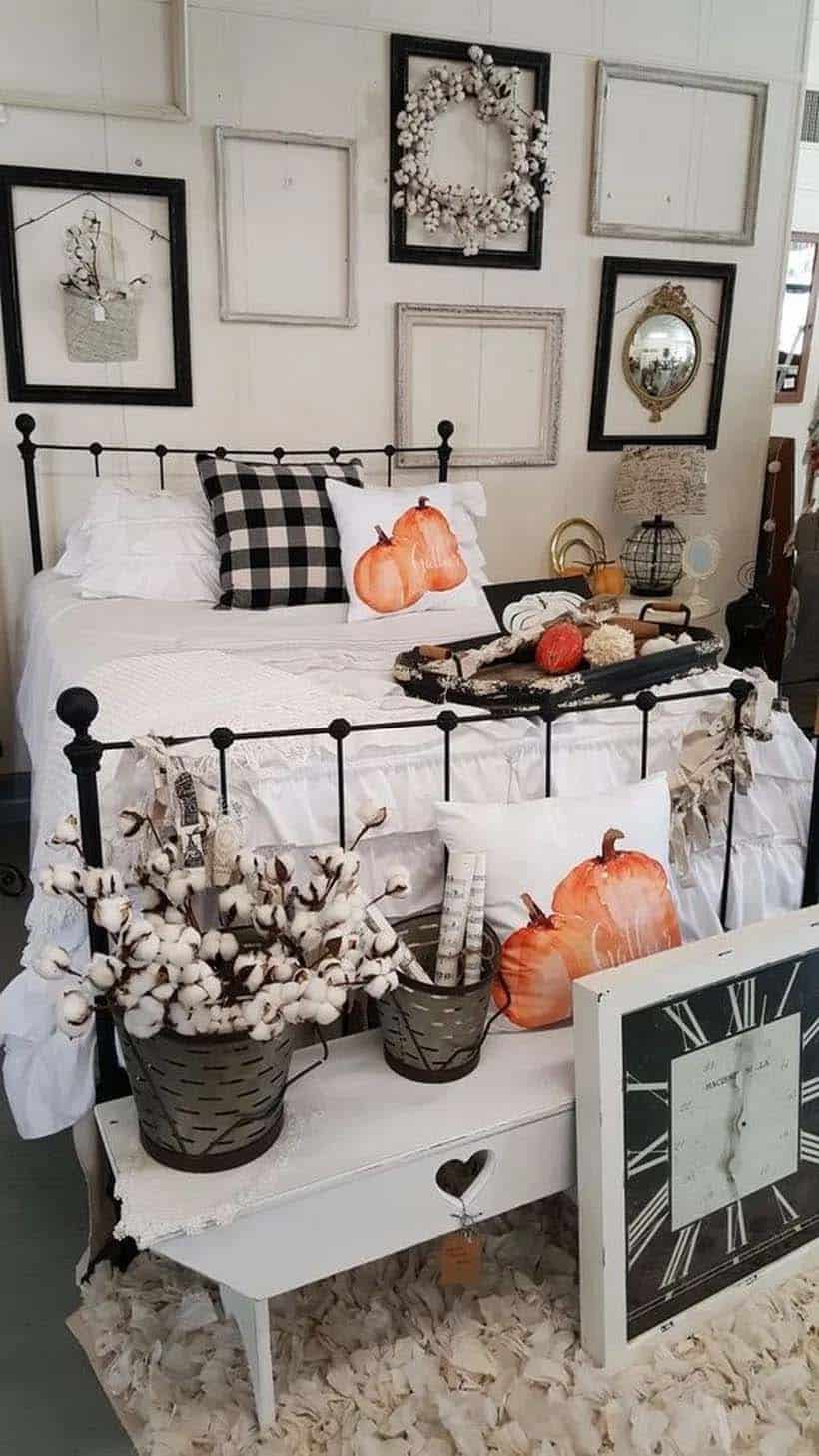 Fall bedroom decor white bedroom with black accents and orange pumpkin throw pillows and orange and white gordes.