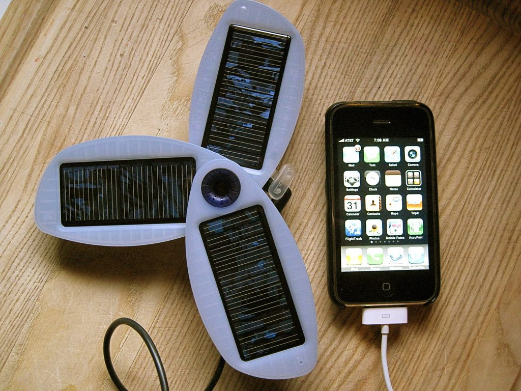 a phone connected to a portable solar charging array