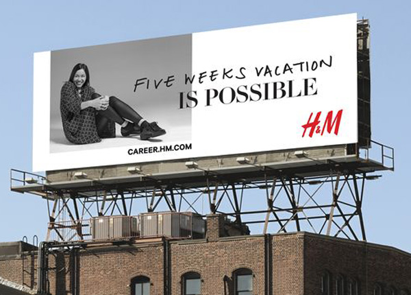 "An H&M billboard advertisement with a black and white photo of a woman and a message ""Five weeks vacation IS POSSIBLE""."
