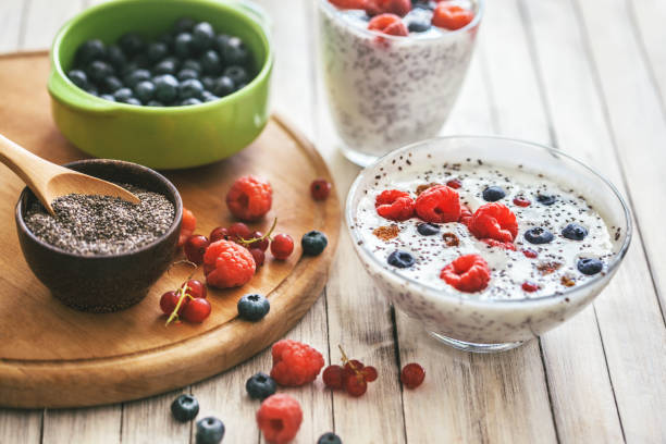 Chia seeds is high in omega 3 fatty acids that is being used as a healthy keto option. A glass of fruits and chia seeds.