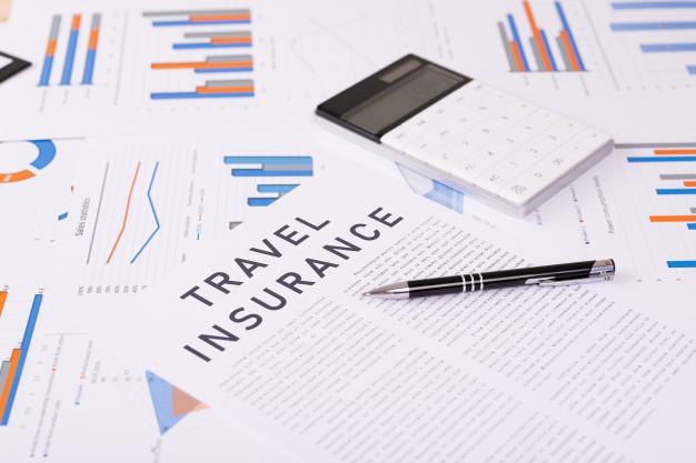 Travel insurance concept, documents on the desktop | Premium Photo