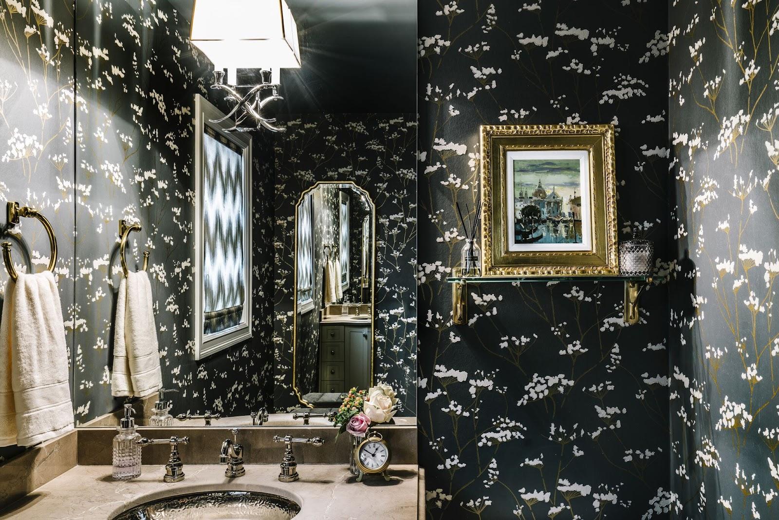 dramatic bathroom black wallpaper gold gilded framed art powder room classic calgary leanne bunnell interiors