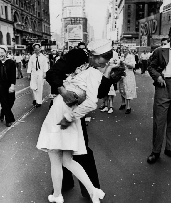 An American sailor kisses a nurse among the crowd in Times Square celebrating V Day, the long-awaited victory over Japan in WWII, on August 14, 1945.