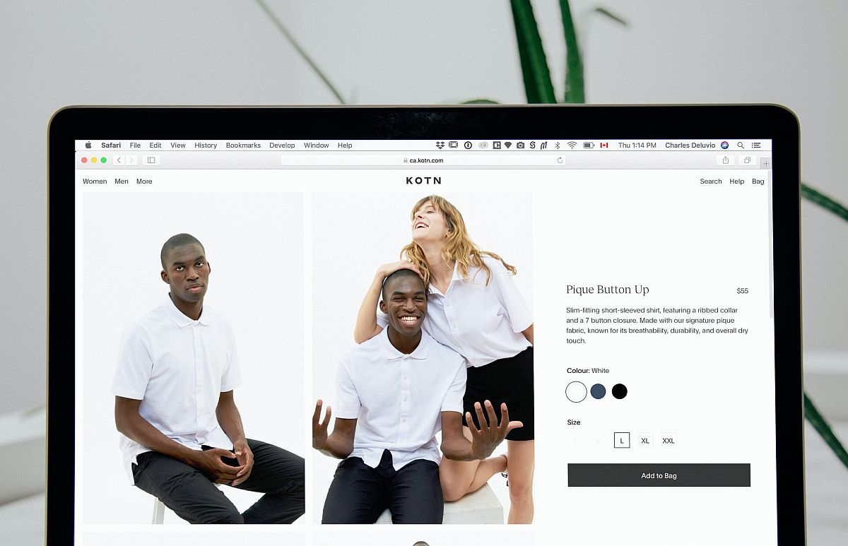 Computer screen with image of fashion website with male model on the left and a male and female model on the right with add to bag button