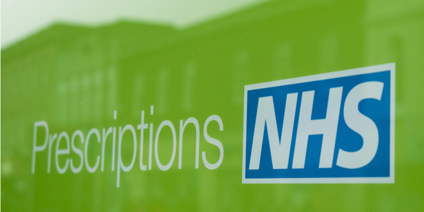 NHS-prescriptions-sign-on-front-of-pharmacy-in-green