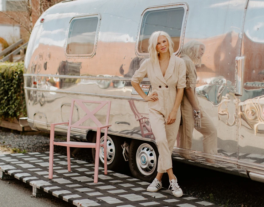 Picture of Amanda Goetz next to silver camper