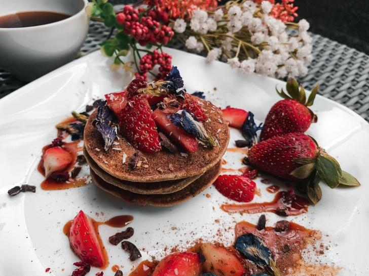 three pancakes topped with berries