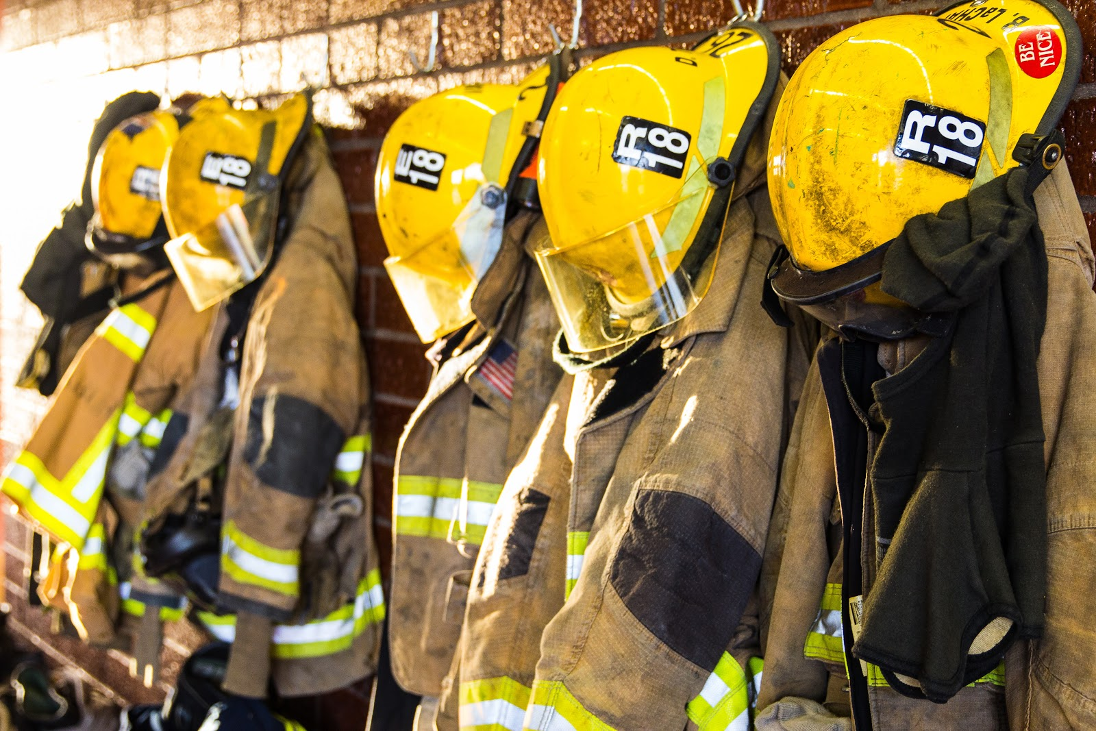 a row of yellow fireman uniforms