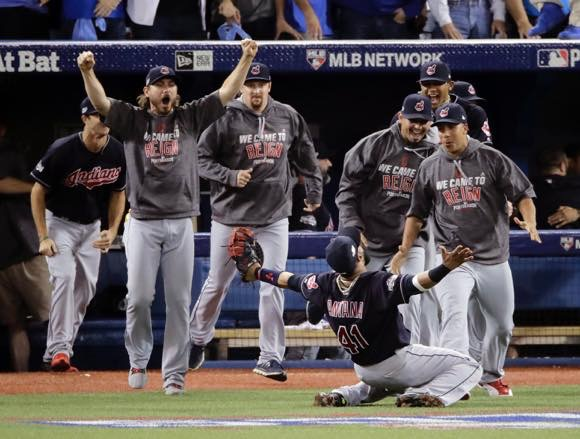 Cleveland Indians first baseman Carlos Santana celebrates after making final out  against the Toronto Blue Jays in the American League Championship Series, Oct 19th, 2016. photo credit: AP Images