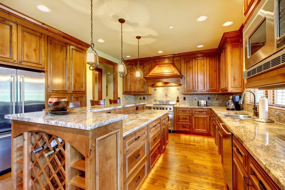 http://streaming.yayimages.com/images/photographer/iriana88w/0d6208c1add7a66c37acfb808944fab8/luxury-wood-kitchen-with-granite-countertop.jpg
