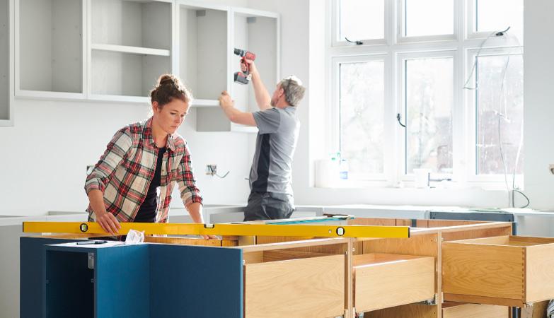 A couple doing kitchen renovations