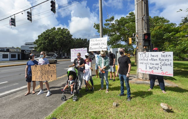Russian asylum seekers protest at the Paseo Loop in Hagåtña on Nov. 14, 2020. The group of Russian nationals, some of whom have been waiting years to schedule interviews or hear back from the USCIS, hope to spread awareness, gain support and, hopefully, see some action from the federal government.