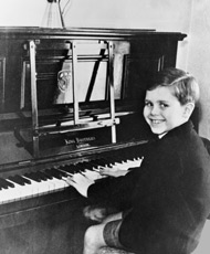 Elton playing piano at the age of 6