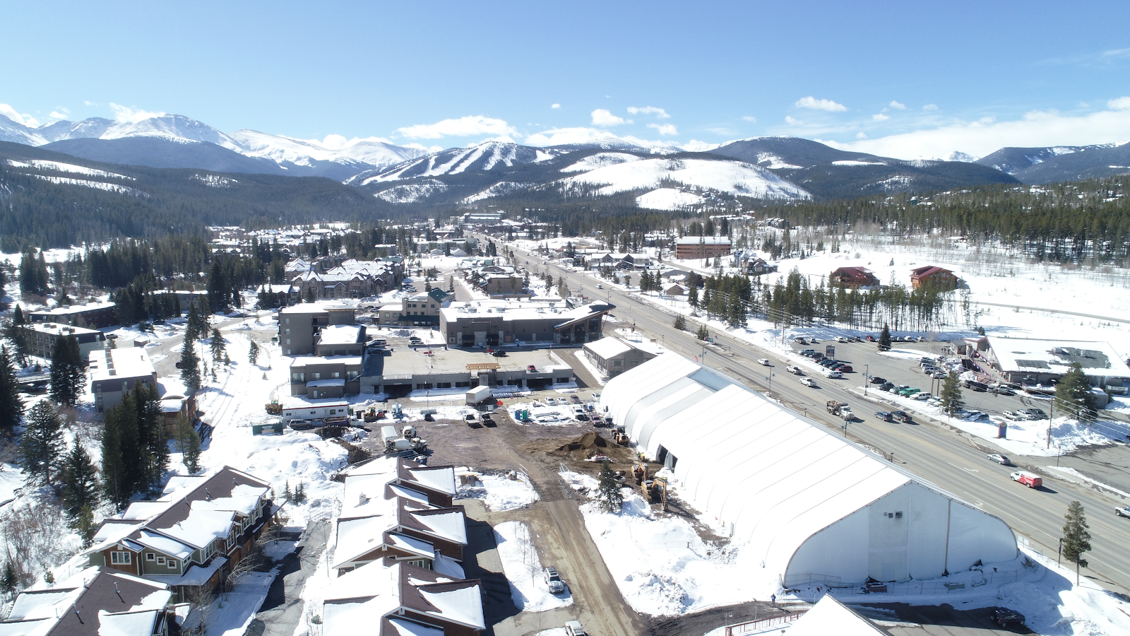 Large snowy construction site with Allsite tensioned fabric structure aerial view of the structure and surrounding area