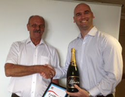 Jim Richards, Driver Hire Birmingham (left) collects his award from local Area Development Manager, Michael Wakeham
