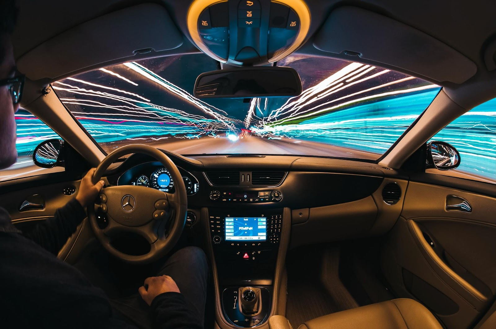 A long exposure, wide angle, car interior photo