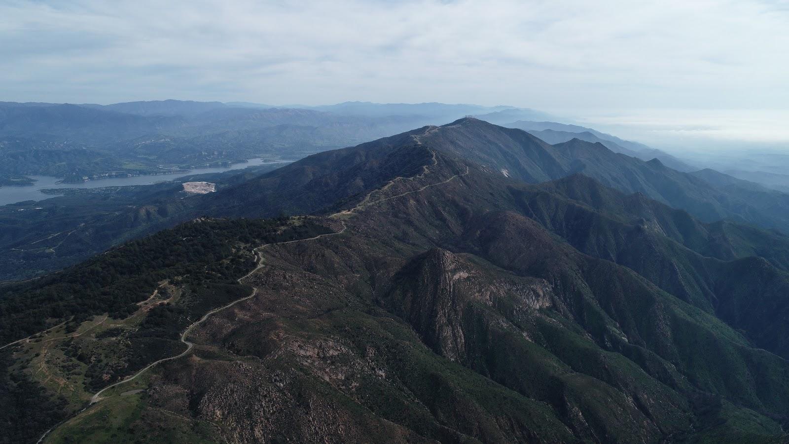 Bike climb Refugio Road Climb - W. Camino Cielo - aerial drone photo of roadway, mountains, finish