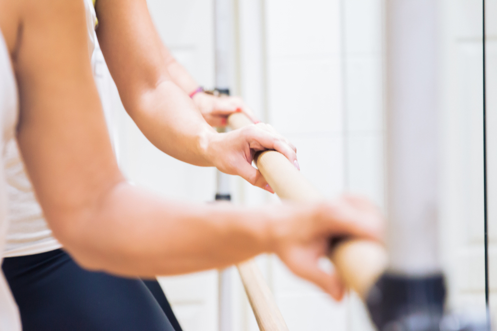 hands at the ballet barre