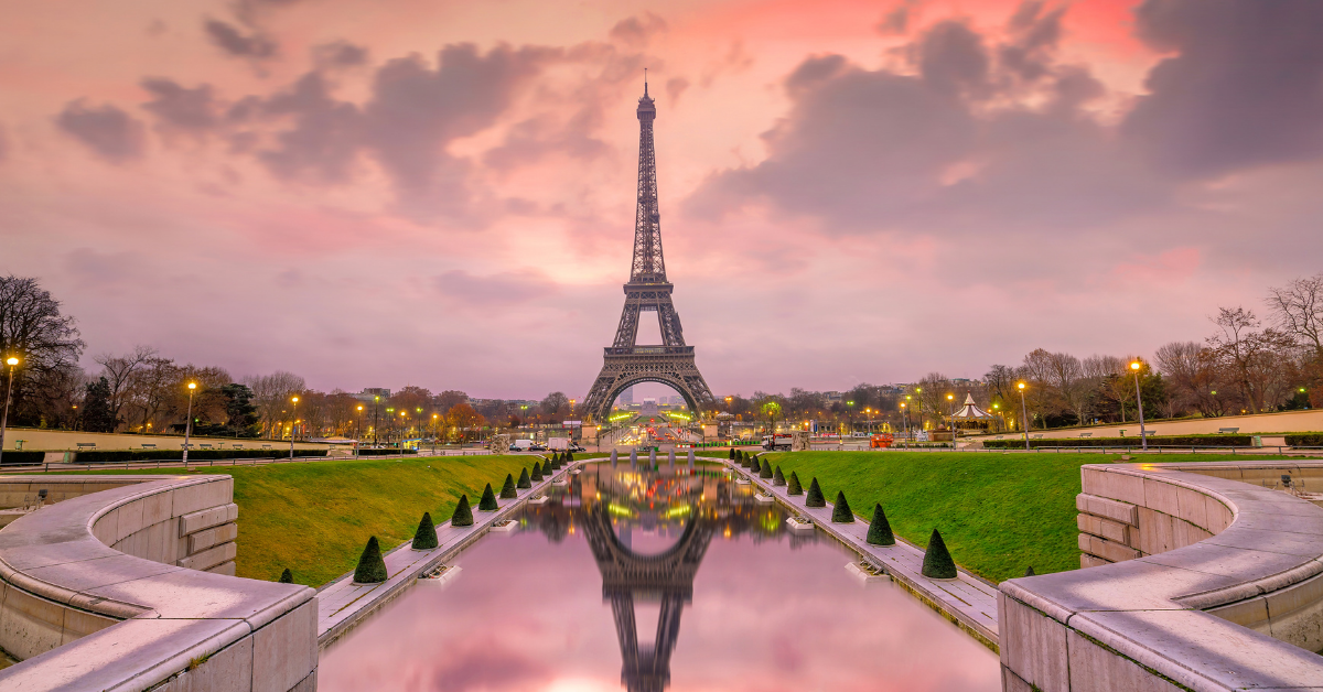 The eiffel tower in paris with a pink sunset