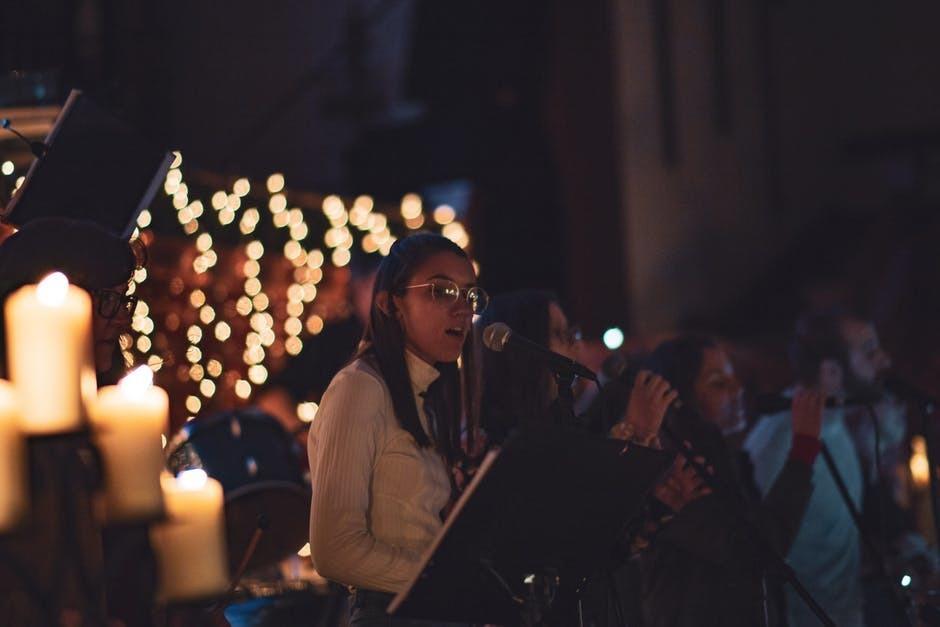 Selective Focus Photo of Women Singing
