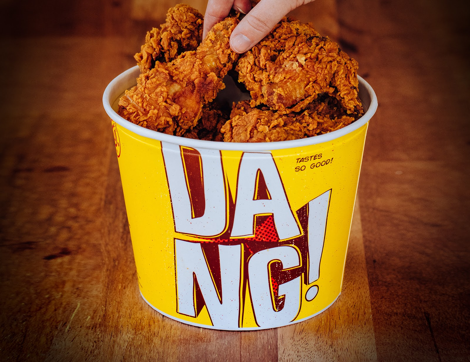 The Chicken Treat bucket packaging is designed in the brand's comic book style and features the word
