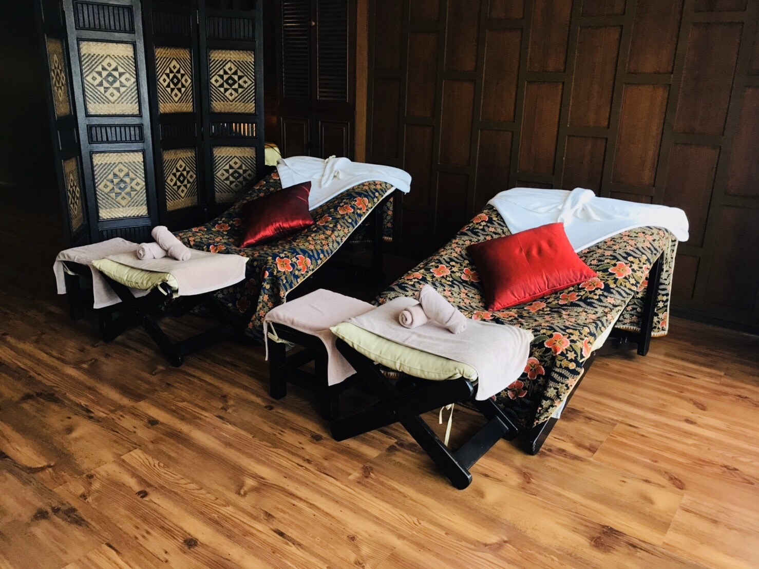 Reclining spa chairs in traditional Thai pattern.
