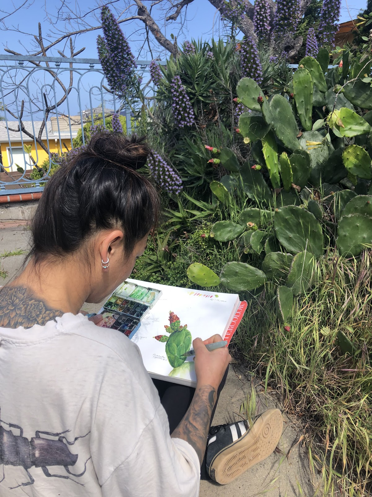 Yvonne Byers painting a watercolor of a cluster of cacti