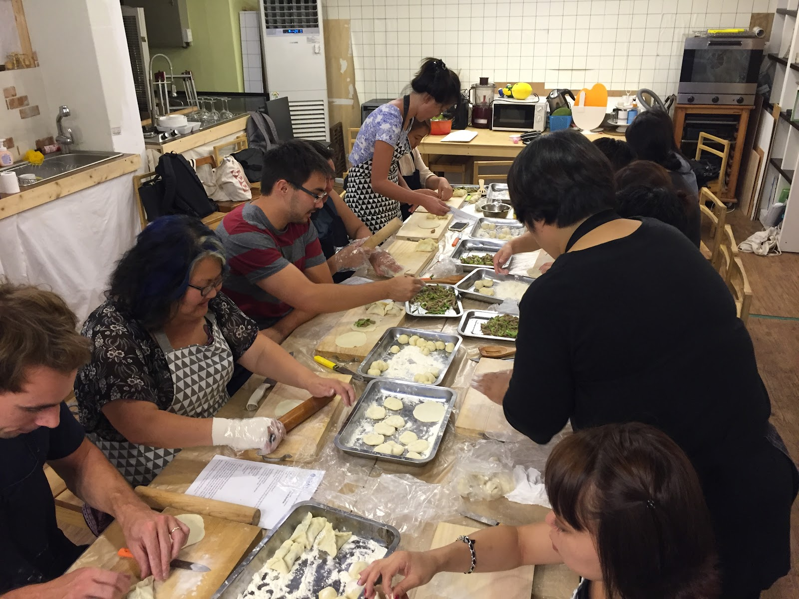 Do it yourself cooking class global overseas here the participants are making the summer dumplings its harder than it looks solutioingenieria Choice Image